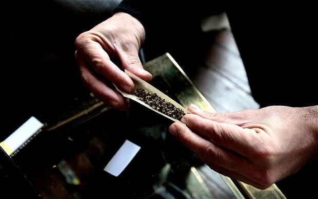 hands rolling joint