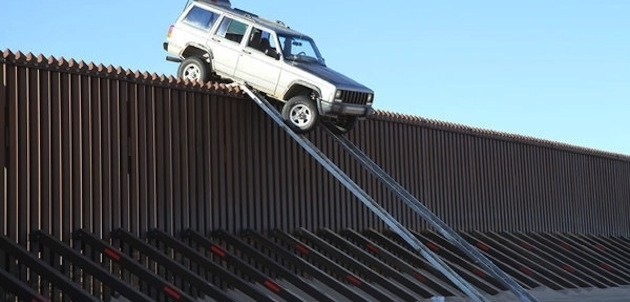 Smugglers attempt to drive an SUV right over the border.