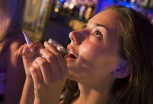 Young Woman Drinking Alcohol and Smokig Marijuana