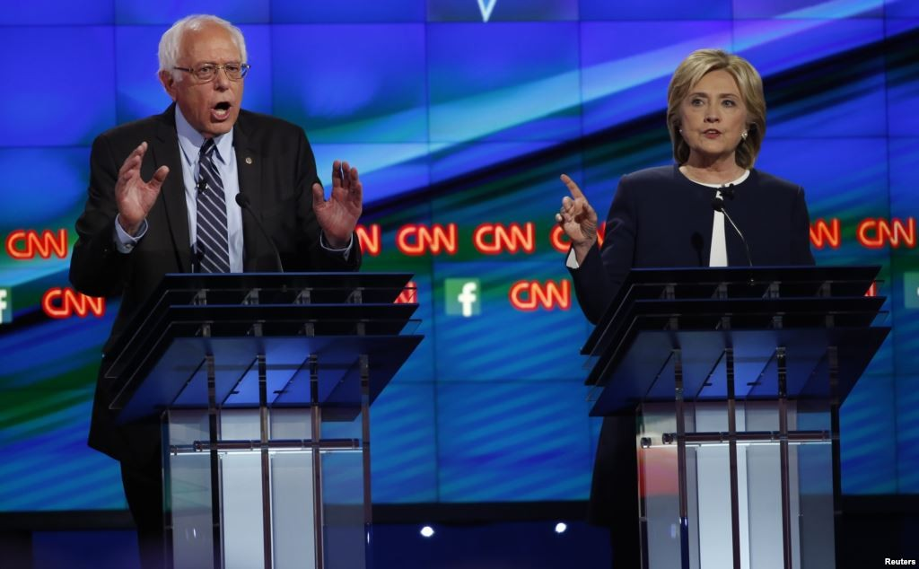 Bernie Sanders and Hillary Clinton at the DNC debate in October