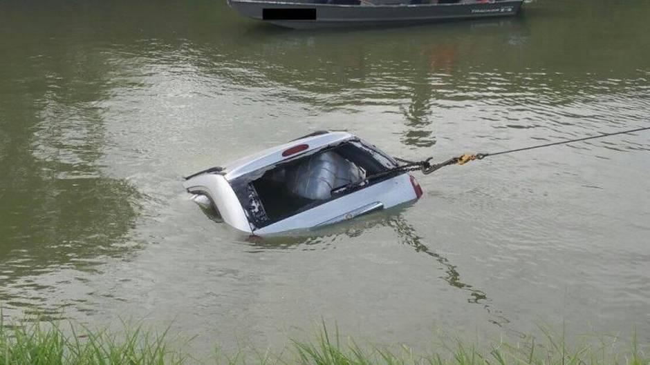 Minivan driver into river
