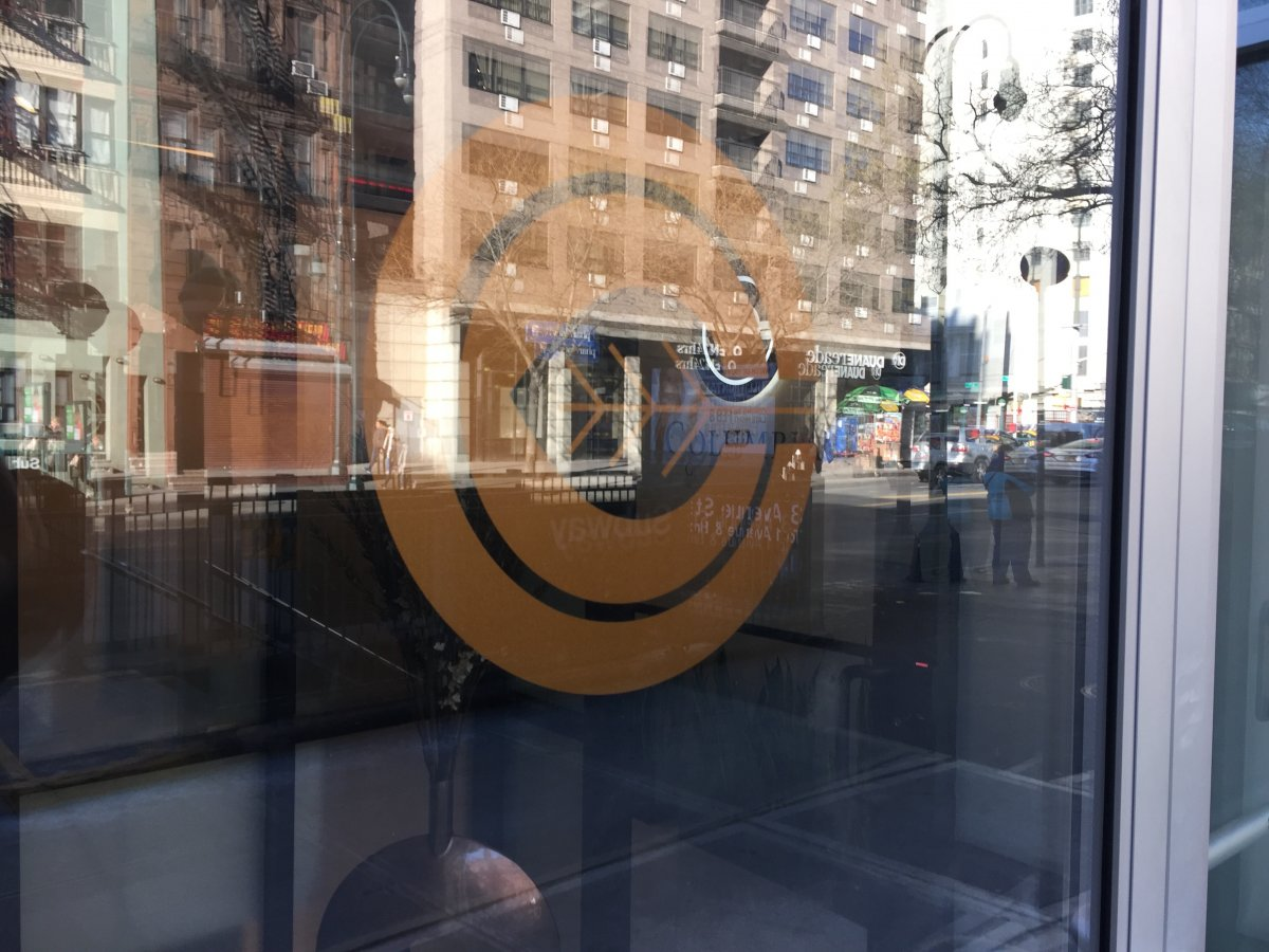walking-in-from-14th-street-the-first-thing-you-see-is-the-columbia-care-logo-of-nested-cs